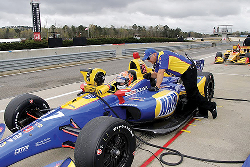 Rossi and Brian Fellows on track with car