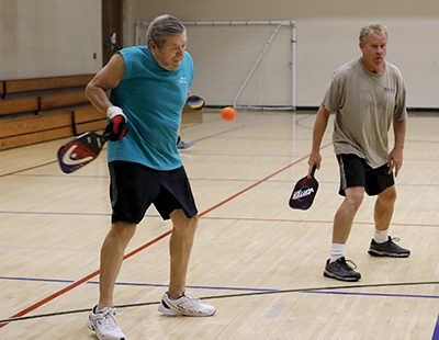 Larry Rusk and Jim Kedwell on pickleball court