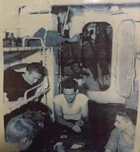 WWII photo of men playing cards aboard LST-325